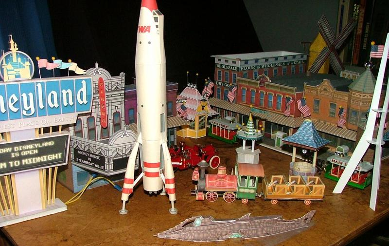 Photograph of a model version of Disneyland, featuring a model train and rocketship
