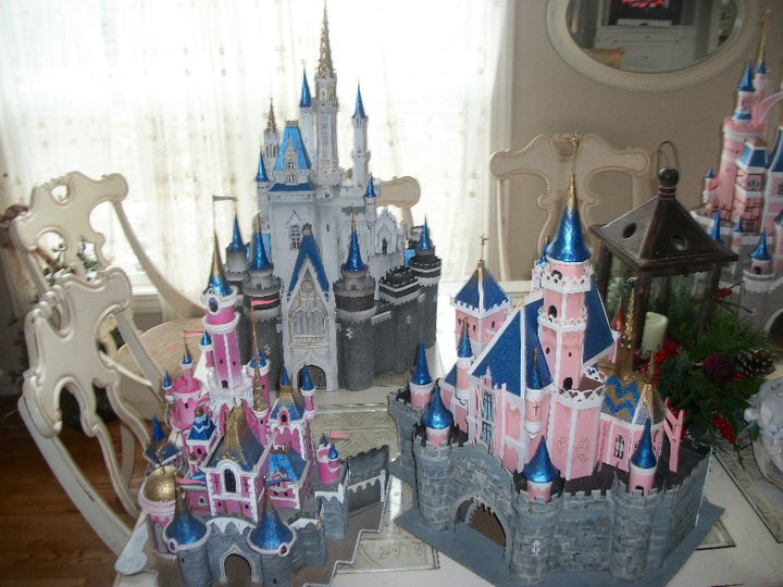 Photograph of model versions of several different Disney park castles