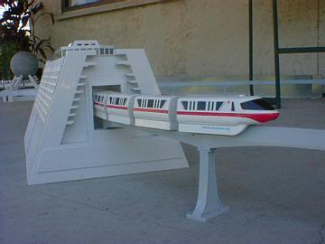 Close-up photograph of a model version of the Epcot monorail, set up on a patio