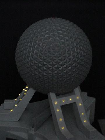 Photograph of a model version of the Epcot ball, featuring working lights